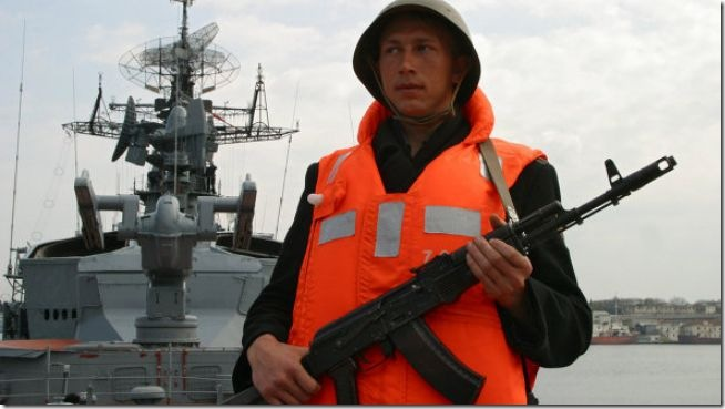 A Russian soldier is seen on Smetlivy warship